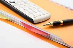 Concept of business. Pen, calculator and notepad. Stock Photos