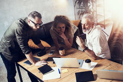 Concept of business people brainstorming.Bearded man talking with account director and creative manager to finding great Stock Image