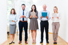 Concept - business people in office standing in row Royalty Free Stock Photos