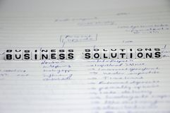 Concept of business solutions. Plan for business solutions on paper and writing your best strategy royalty free stock photo