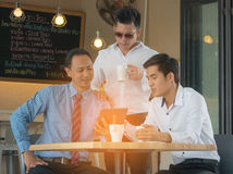 Concept Business talk Meeting Relex. In coffee shop,table tablet and coffee on workplace in coffee shop Royalty Free Stock Photos