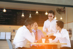Concept Business talk Meeting Relex. In coffee shop,table tablet and coffee on workplace in coffee shop Stock Photography