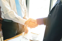 Concept Business talk  Relax. Businessman handshake success in coffee shop Stock Image