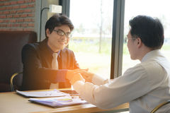 Concept Business talk  Relex. Businessman handshake success in coffee shop Stock Images