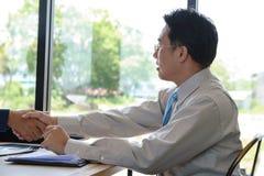 Concept Business talk  Relex. Businessman handshake success in coffee shop Stock Photo