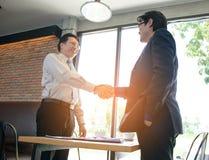 Concept Business talk  Relex. Businessman handshake success in coffee shop Stock Images