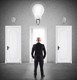 Concept of businessman choosing the right door. Businessman choosing the right door in which to enter Royalty Free Stock Photo