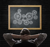 Concept of businessman looking on blackboard with Stock Photo