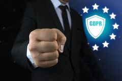 Concept businessman show fist with icon General Data Protection Regulation GDPR Stock Photo