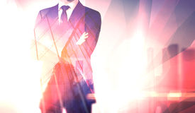 Concept businessman wearing modern suit with his arms crossed. Double exposure. Horizontal, visual effects, flares Stock Images
