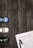 Concept of buying car on dark wooden background top view Royalty Free Stock Photo