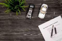 Concept of buying car on dark wooden background top view.  Royalty Free Stock Photos