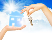 Concept of buying house. On blue sky background Royalty Free Stock Photo
