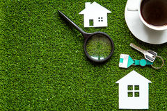 Concept of buying house on green background top view Stock Photography