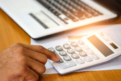 Concept,Calculate income and expenses. Stock Photos