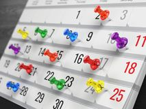 Concept of calendar, reminder, organizing - calendar with colorful pins Royalty Free Stock Images