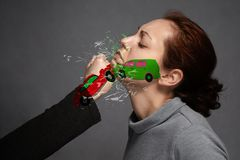 The concept of a car accident, insurance.A staged car accident involving a girl`s face and a blow to the chin . Painted the car i royalty free stock photos