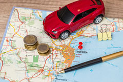 Concept of car journey, map and money. Pen Royalty Free Stock Photo