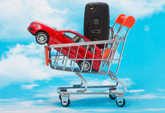 Concept car sales. In a store basket Royalty Free Stock Image