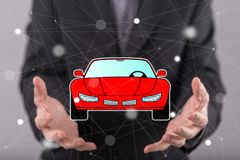 Concept of car transport. Car transport concept above the hands of a man in background Royalty Free Stock Image