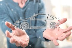 Concept of car transport. Car transport concept above the hands of a man in background Royalty Free Stock Photography