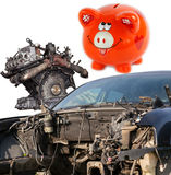 Concept of Car wreck and orange piggy bank style money box Stock Photos