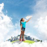 Concept of careless happy childhood with girl dreaming about future Royalty Free Stock Images