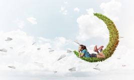 Concept of careless happy childhood with girl dreaming about som Royalty Free Stock Images