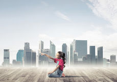 Concept of careless happy childhood with girl dreaming about som Royalty Free Stock Photo