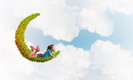 Concept of careless happy childhood with girl dreaming about something Royalty Free Stock Photo