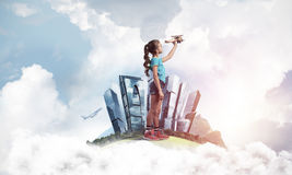 Concept of careless happy childhood with girl dreaming to become Stock Images