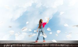 Concept of careless happy childhood with girl dreaming to become pilot royalty free stock image