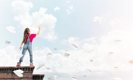 Concept of careless happy childhood with girl dreaming to become pilot stock image