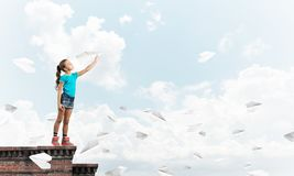 Concept of careless happy childhood with girl dreaming to become pilot stock images