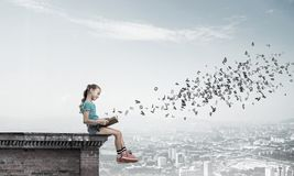 Concept of careless happy childhood with girl exploring this wor Royalty Free Stock Photography
