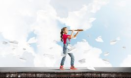 Concept of careless happy childhood with girl exploring this world Stock Photo