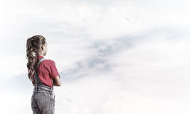 Concept of careless happy childhood with girl looking in future Royalty Free Stock Images