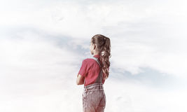 Concept of careless happy childhood with girl looking in future Stock Photo