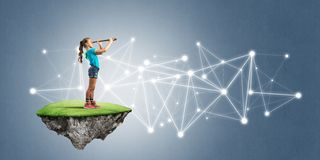 Concept of careless happy childhood with girl looking in spyglass. Cute smiling girl on floating island presenting social connection concept Royalty Free Stock Photos