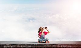 Concept of careless happy childhood with girl of school age looking in future Royalty Free Stock Photography