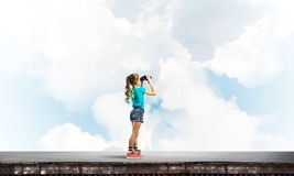 Concept of careless happy childhood with girl of school age looking in future Stock Images