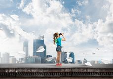 Concept of careless happy childhood with girl of school age looking in future Royalty Free Stock Photo