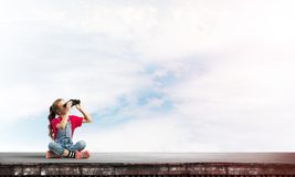 Concept of careless happy childhood with girl of school age looking in future Royalty Free Stock Photos