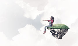 Concept of careless happy childhood with girl showing touch gest Stock Photo