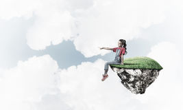 Concept of careless happy childhood with girl showing touch gest Royalty Free Stock Photo