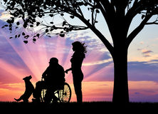 Concept of caring for a disabled person and house of aged. Silhouette of nurse caring for a disabled person in a wheelchair next to dog under tree. Concept of vector illustration
