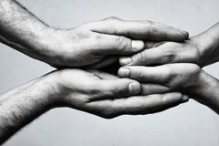 Concept of caring, tenderness, protection. Male and female hands touch each other Royalty Free Stock Photo