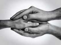 Concept of caring, tenderness, protection. Male and female hands touch each other royalty free stock photos