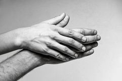Concept of caring, tenderness, protection. Male and female hands touch each other Stock Image