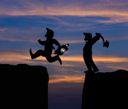 Concept cartoon silhouette, Man hold axe and  Man jumping Royalty Free Stock Photography